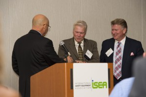 Rich Duffy accepting the Distinguished Service Award from ISEA's Board Chairman and retired MSA Safety executive Erick Beck, and Bill Lambert, President and CEO of MSA Safety.