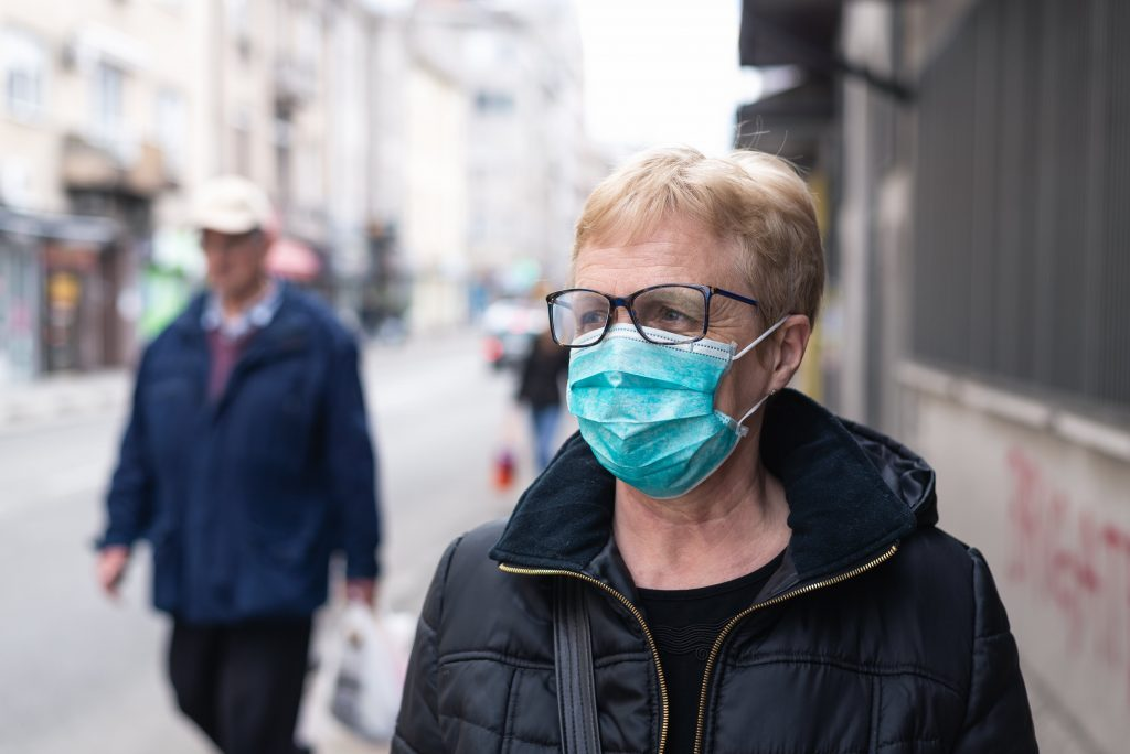 Woman wearing face mask on street